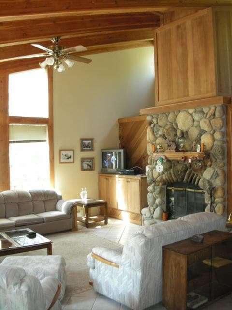 Great Room with Open-Beam Vaulted Ceiling and Natural Stone, Wood-Burning Fireplace with Convenient Gas Starter
