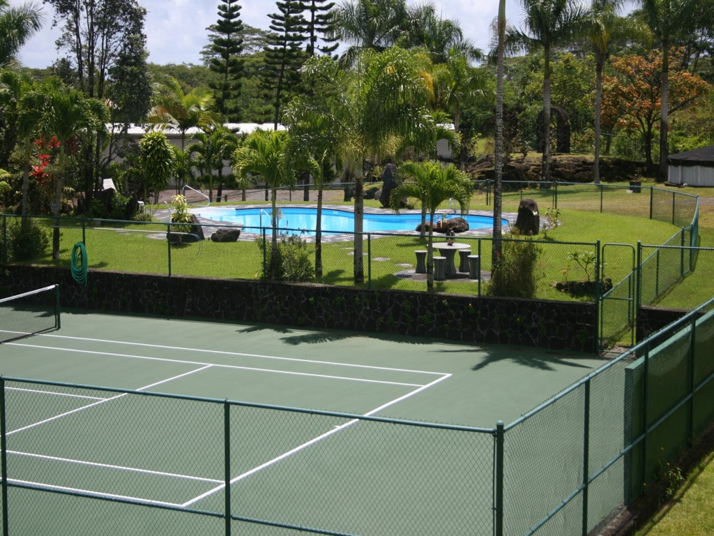 Private regulation tennis court and heated forty foot swimming pool