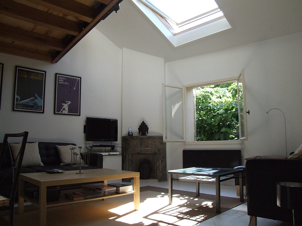 Living room with remote Velux