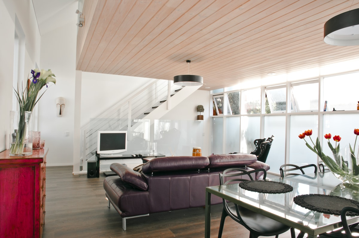 A feature is the lime washed timber ceiling