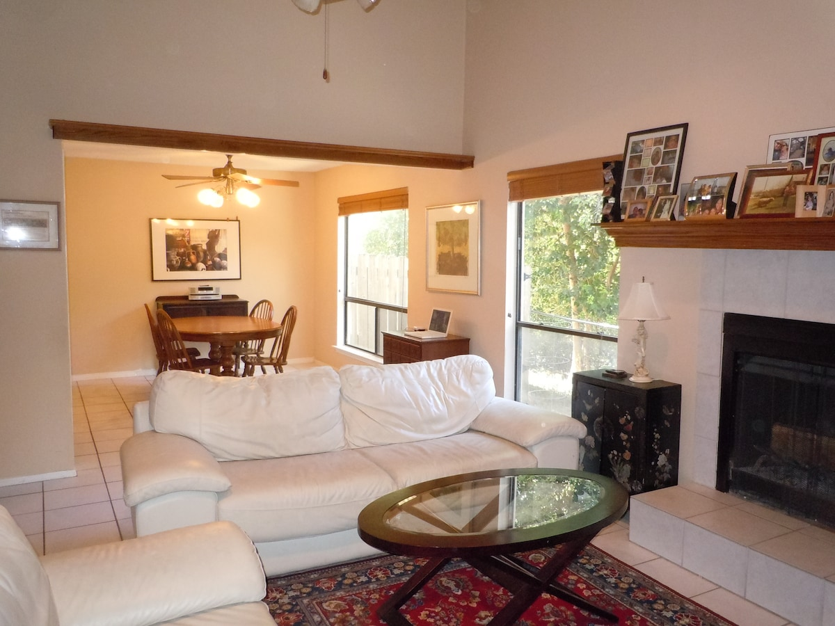 There is plenty of room to relax and have fun downstairs.  The living room and dining room flow together.