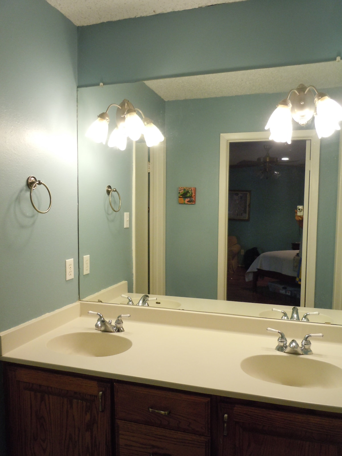 Downstairs bath has double sinks to speed getting ready in the morning.