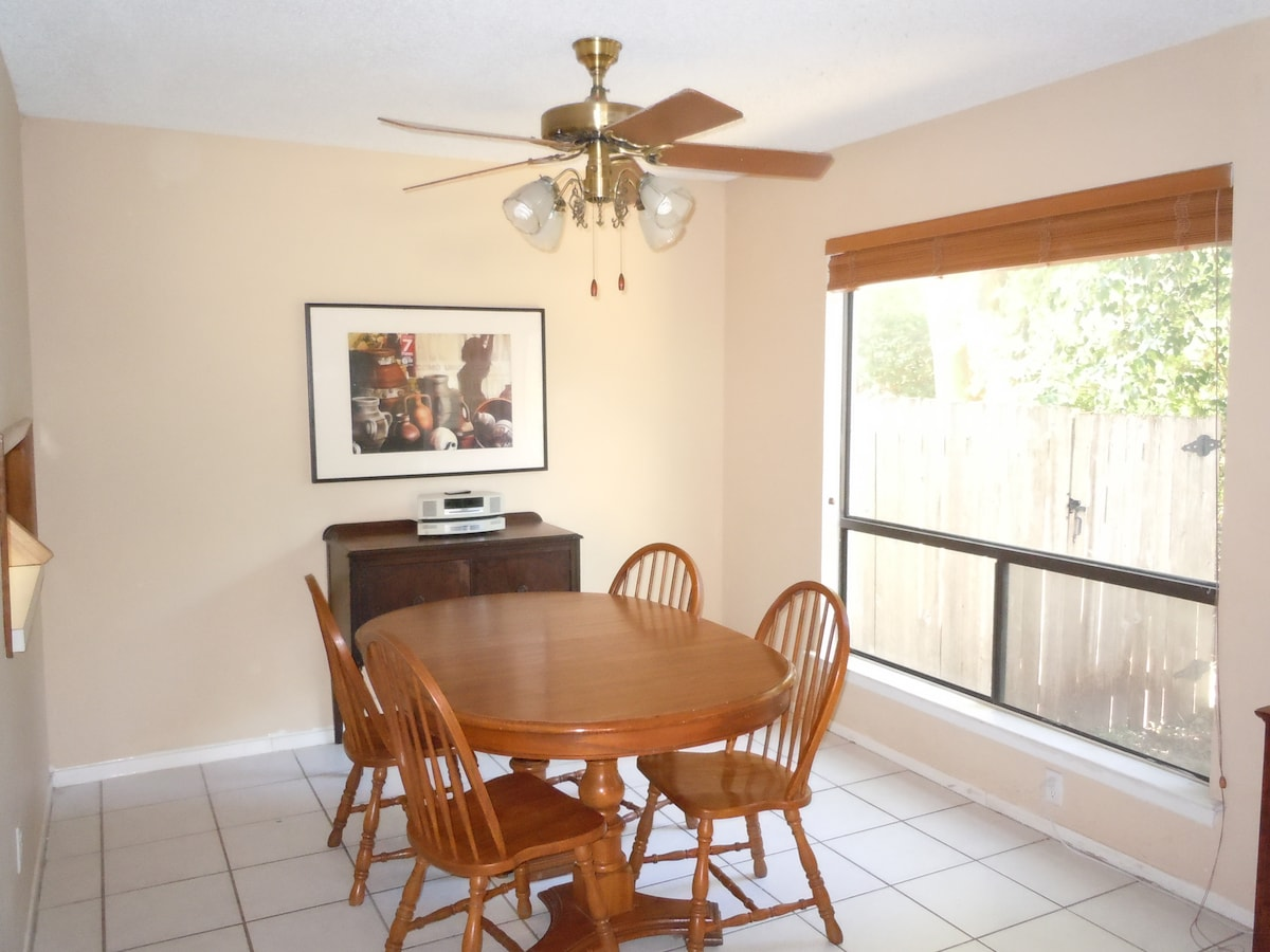 The dining room has seating for 6.  You can use the desk chairs if you need additional seating.