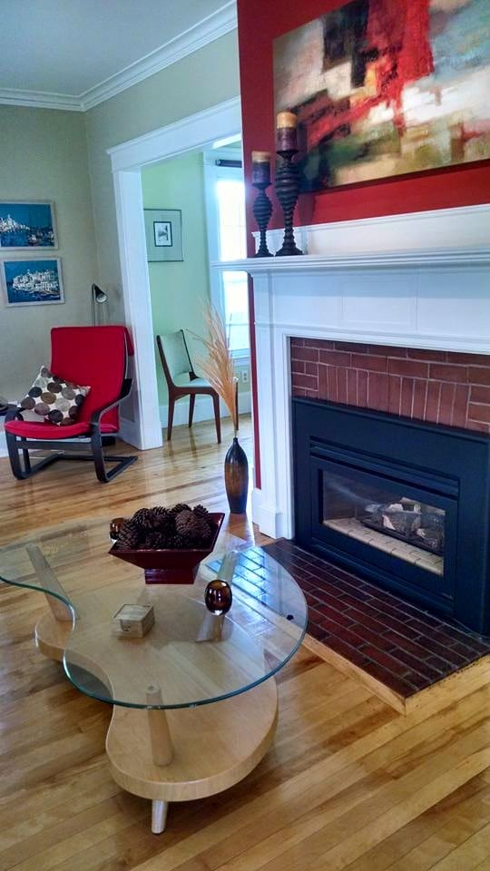 Gas fireplace at the flick of a switch (available in fall - spring). Cool artwork from Goodwill's art sale.