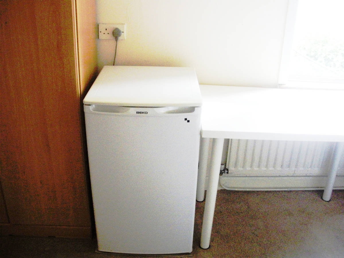 The private fridge and table