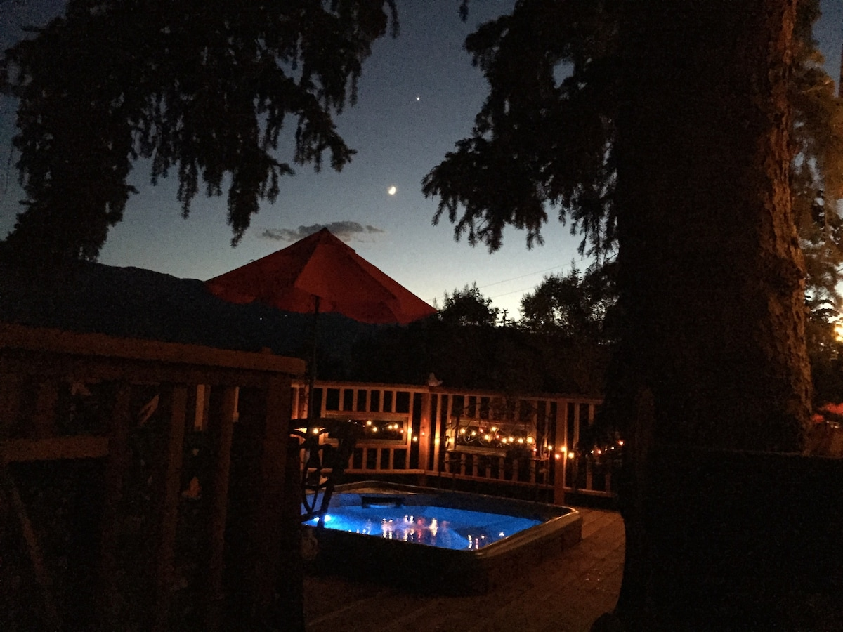 Sunset on newly remodeled redwood deck with hot tub