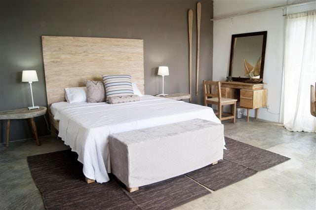 Beautifully decorated bedroom area  with double bed and air-condition.