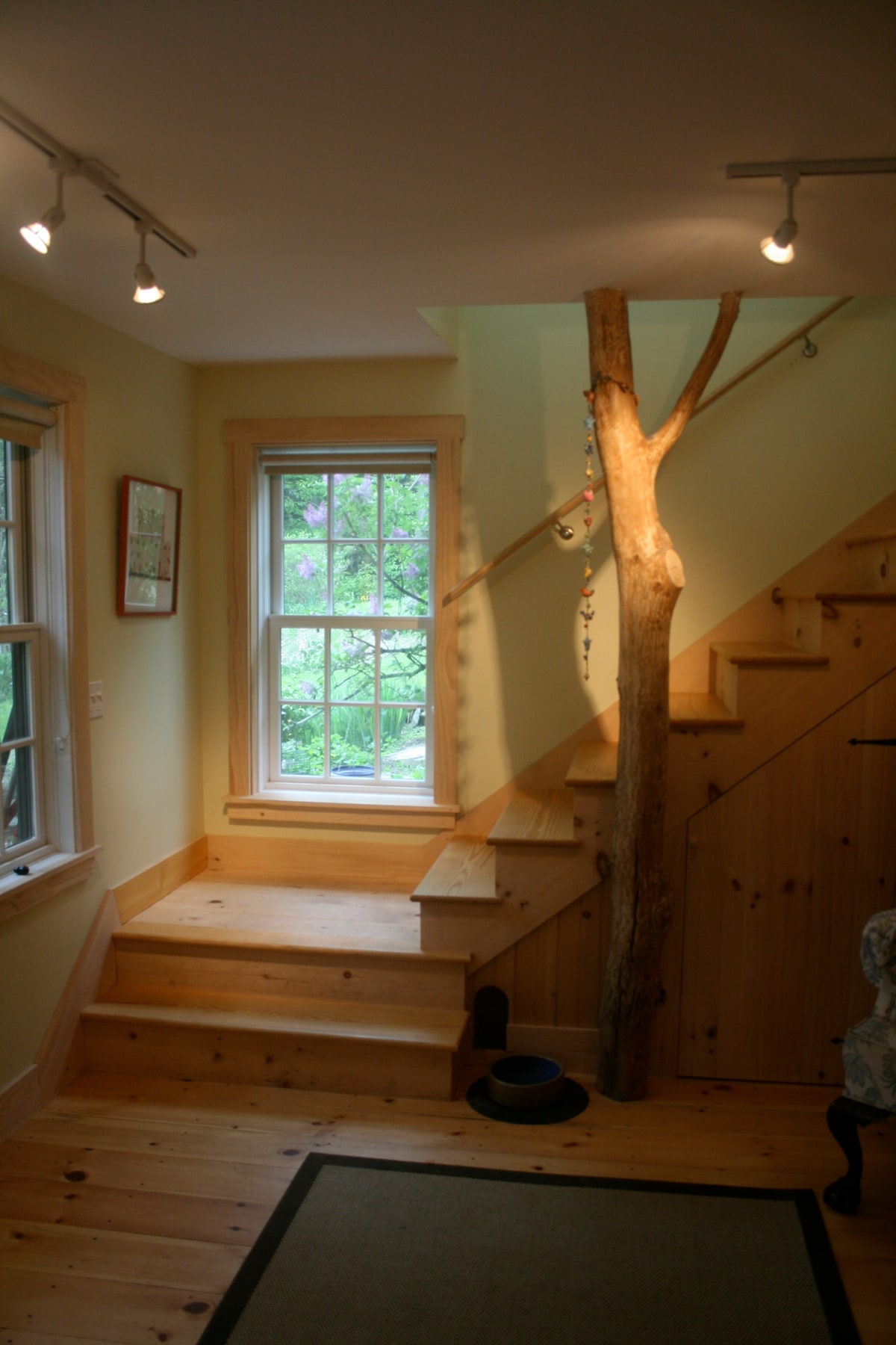 front entry and stairs to second floor.  tree came from our property.