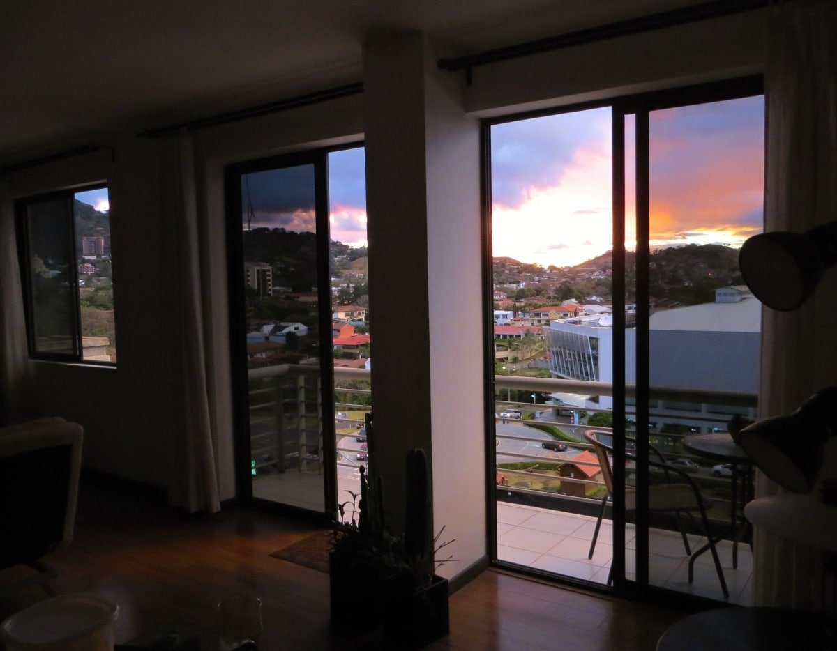 View from open plan living room to the sunset