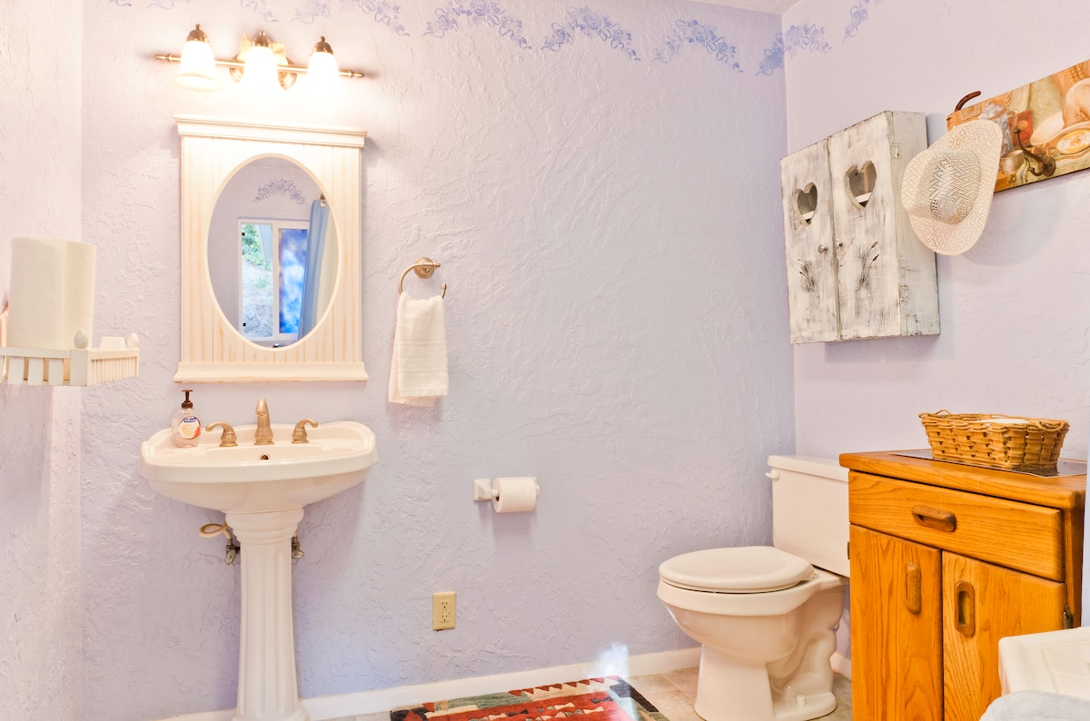 The room with the bed is relatively small, but the bathroom is big enough for the Jacuzzi tub.
