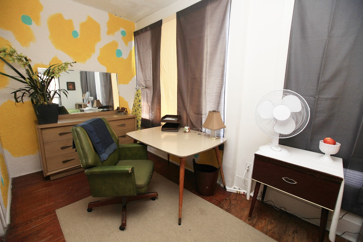 desk and mirror in one of the guest rooms