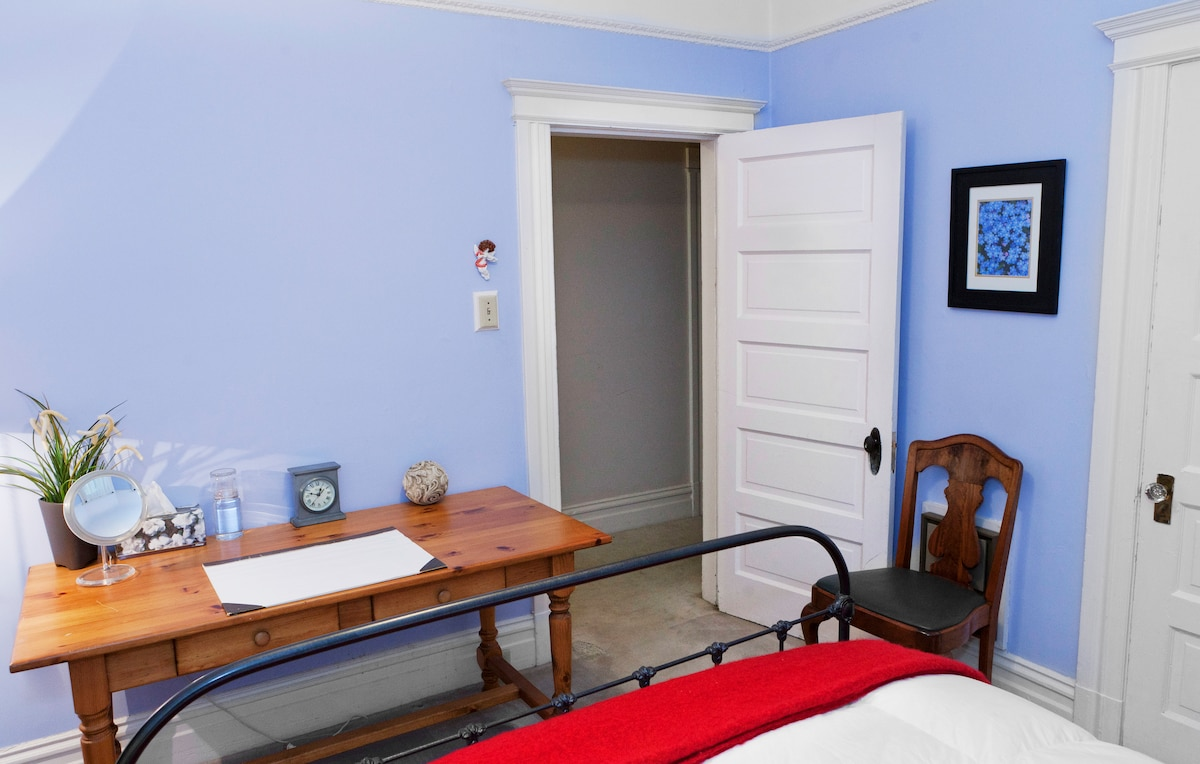 The bedroom door leads directly to the hallway, with the bathroom just a few steps away.