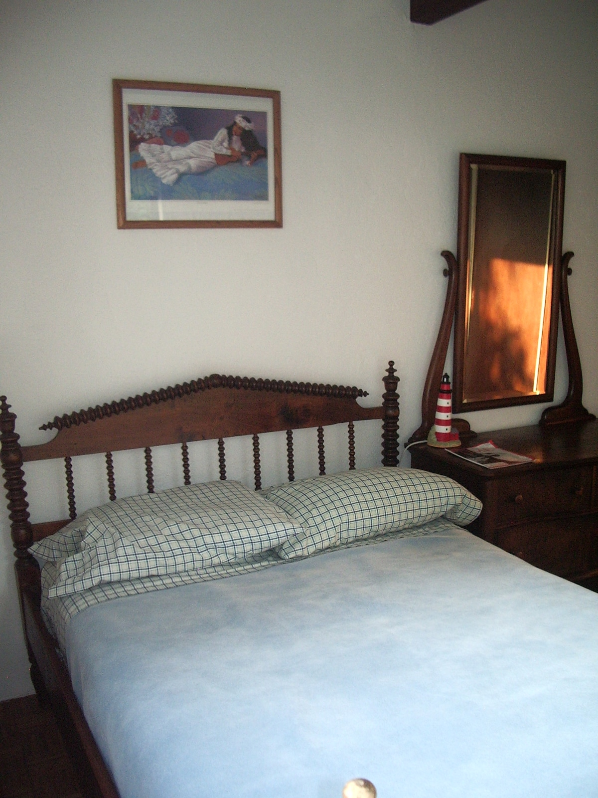 bedroom furnished with antique furniture