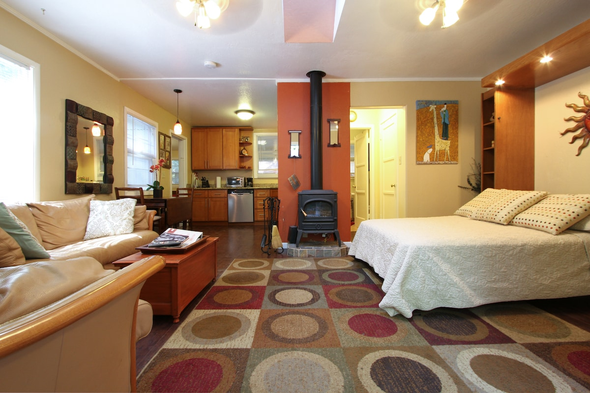 living room and kitchen with Murphy full bed open