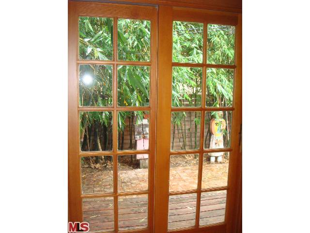french doors leading to your prvt bamboo patio. My sister threw all the pottery in and outside the bungalow.