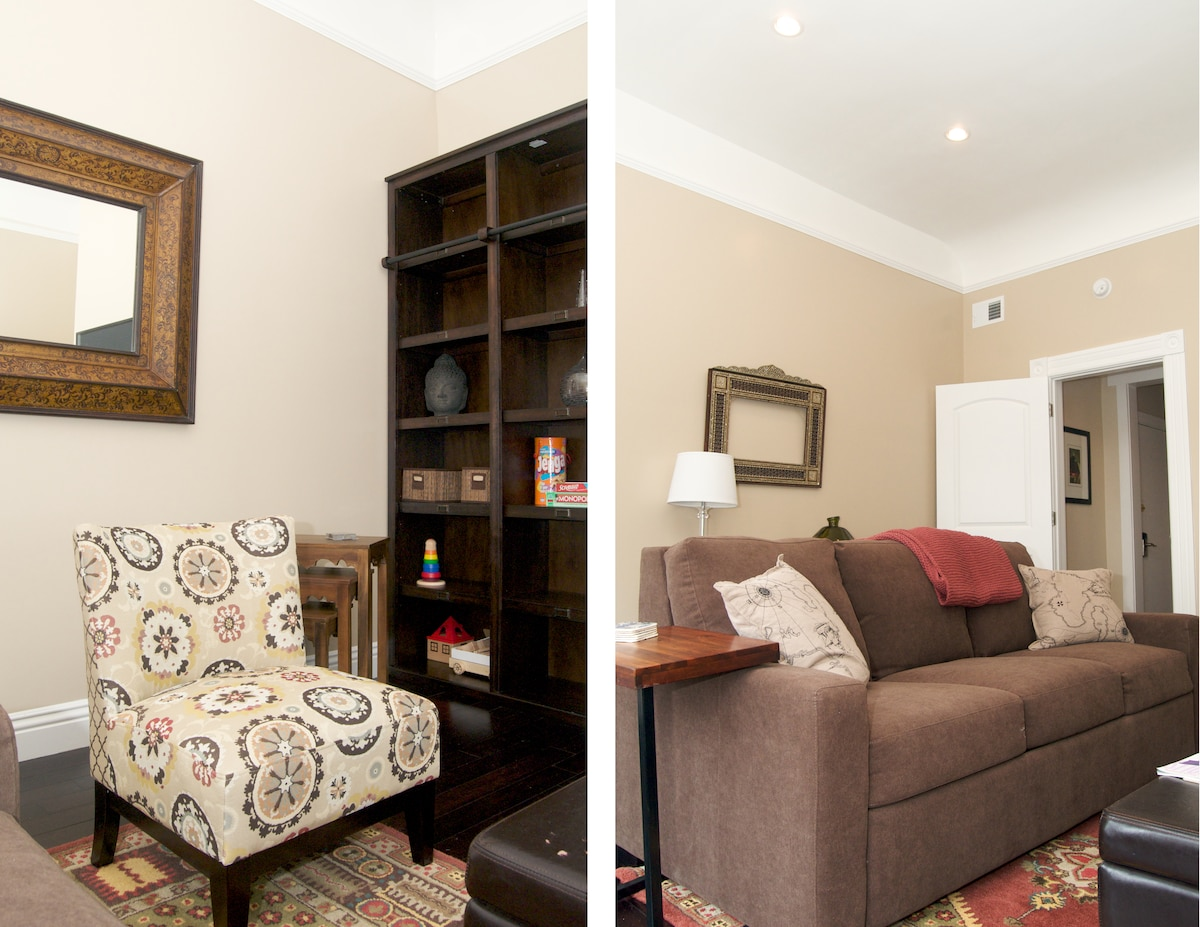 Living room with natural light. Couch pulls out to comfort queen sofa bed.