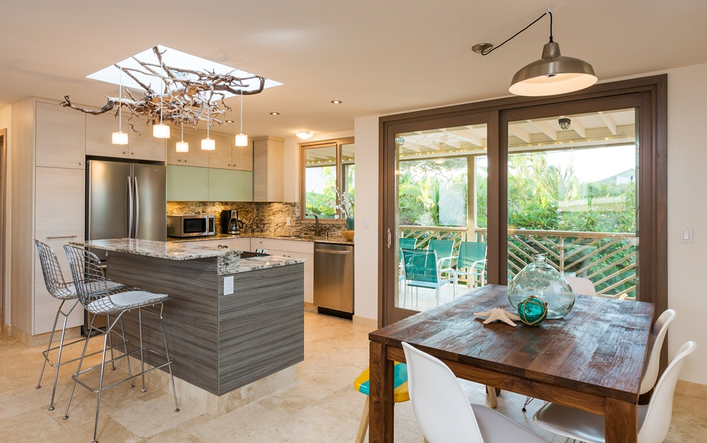 Kitchen with lanai and indoor , outdoor dining and lounging