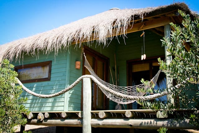 Front view of cabin, thatched deck that gives great shade in the summer months and hammock (essential item in any beach cabin!)