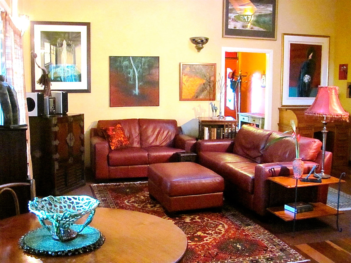 Custom Italian leather sofas,artwoorks and antiques make a cosy living area