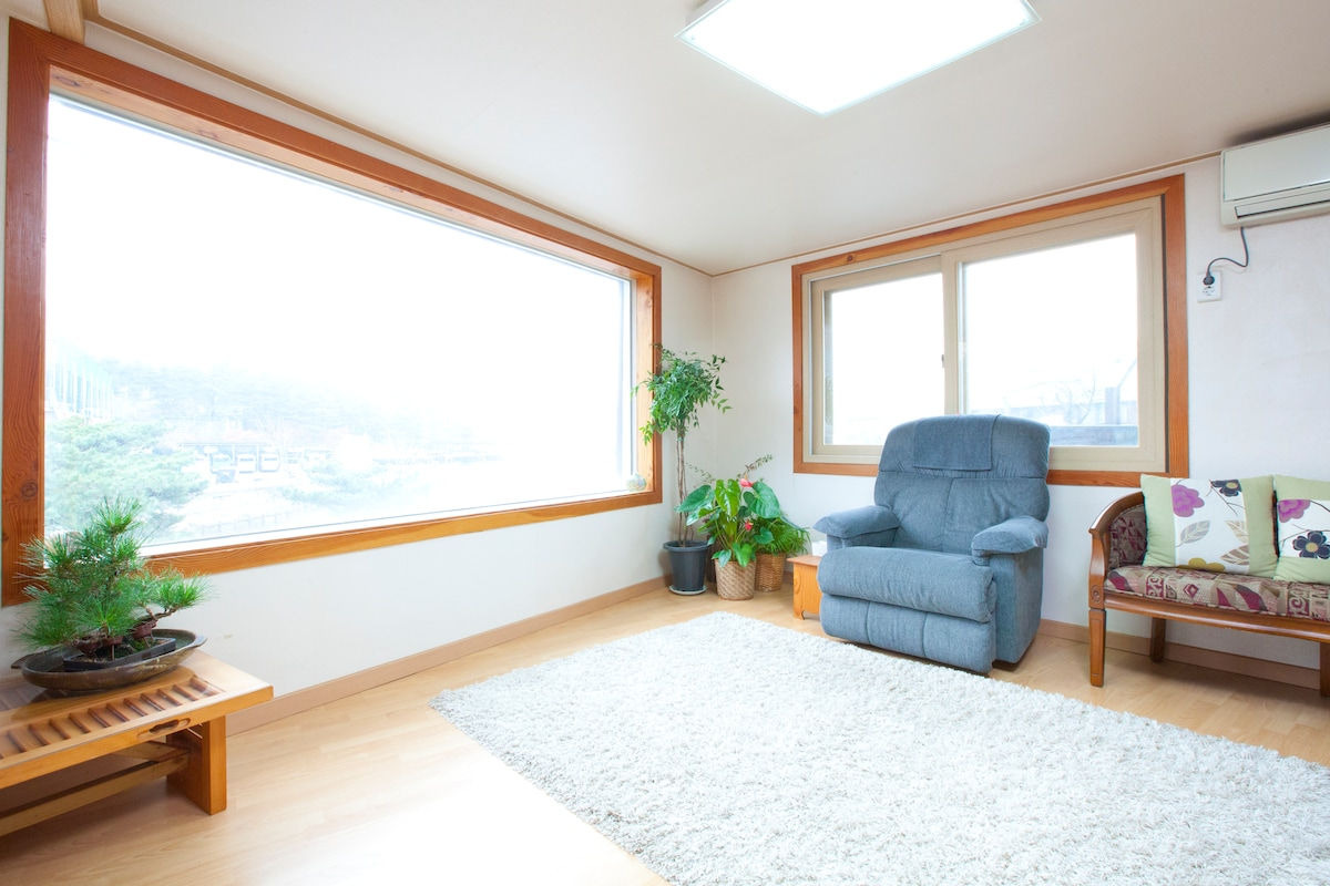 Spacy living room with good looking window views