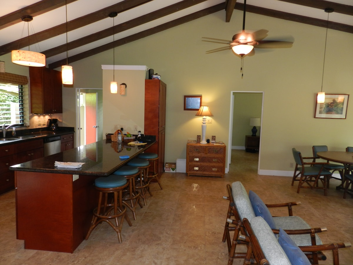 Dining bar, laundry at left beyond kitchen. Door to master bed & bath at right