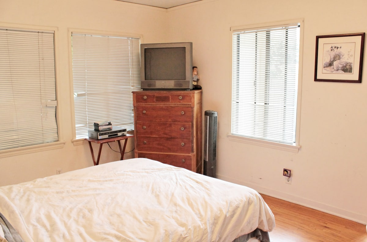bedroom has a TV that can play DVD or VHS. We have a small collection of movies to choose from.