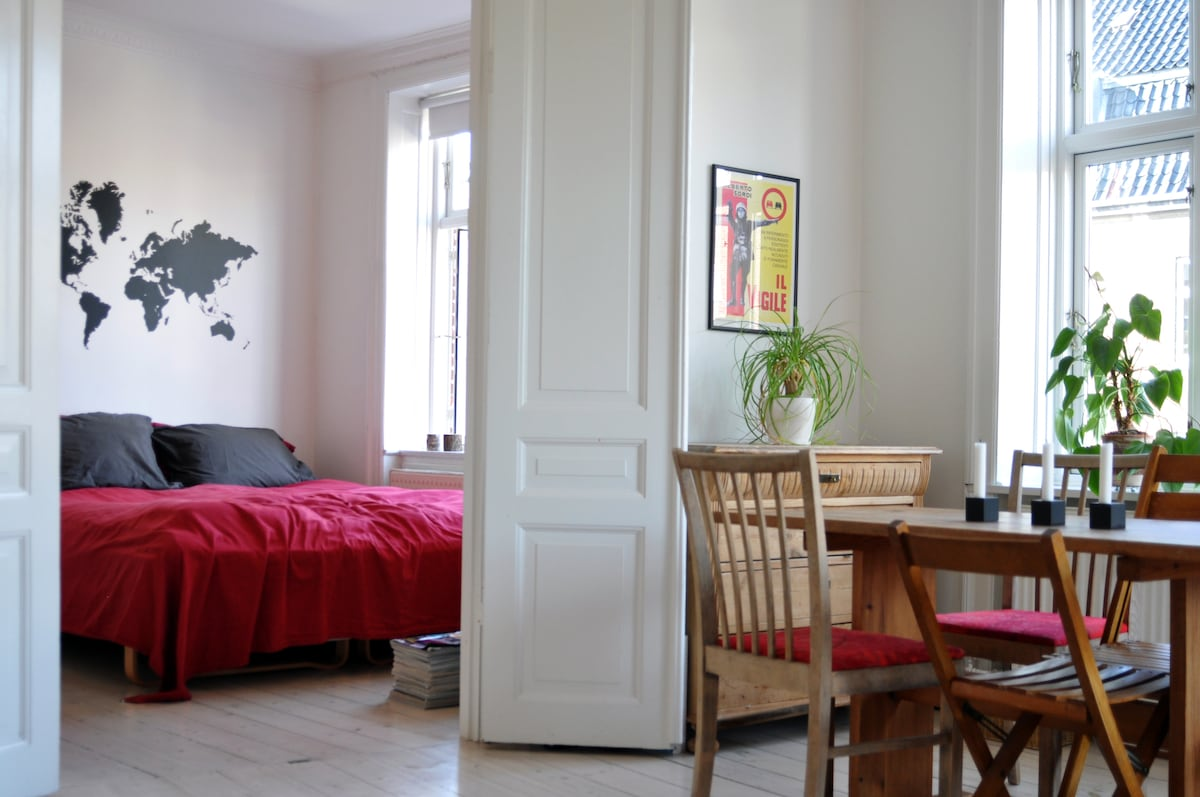 Double doors between one of the bedrooms and the the living room.