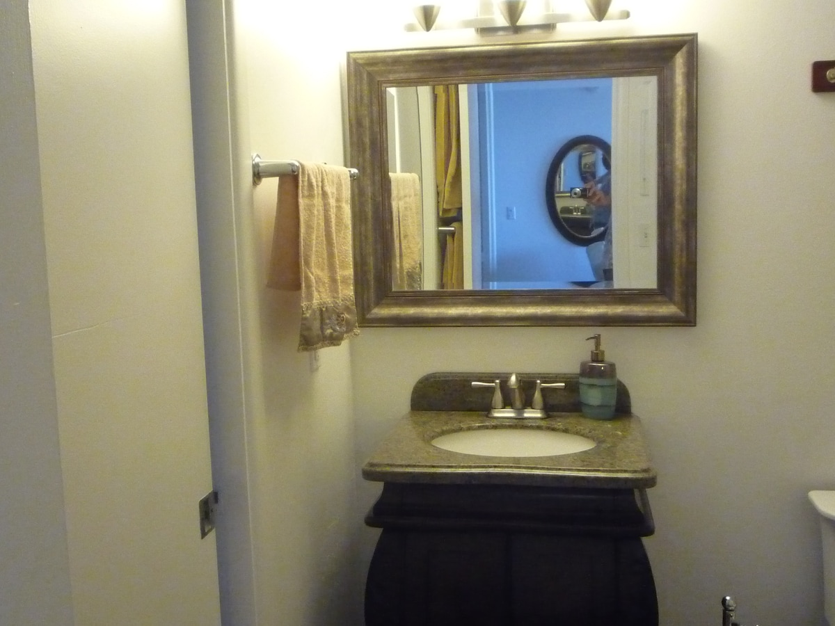 Granite top vanity in bathroom. Shower on right. Nice size closet stocked with hair dryer towels etc.