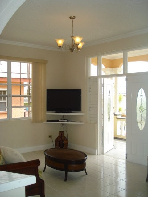 "32 "" Cable LCD TV and DVD Player , Living Room leading to Veranda"