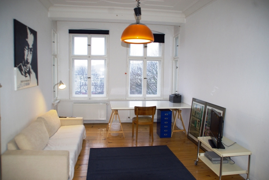 The sofa is very good to sleep on (for 3rd person). Desksize is 200x100cm. Of course there are two identical chairs in the room, but not on the picture :-)