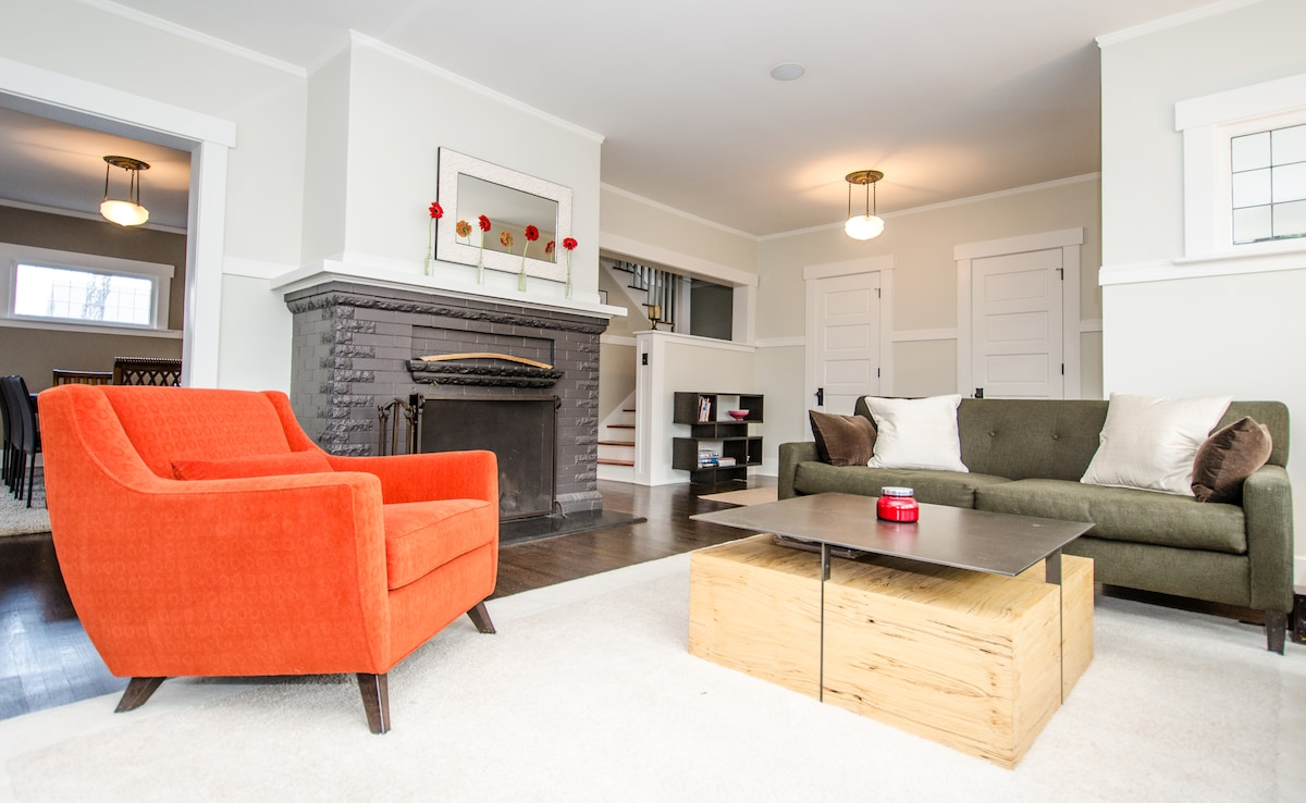 Living room also features a cozy wood-burning fireplace.