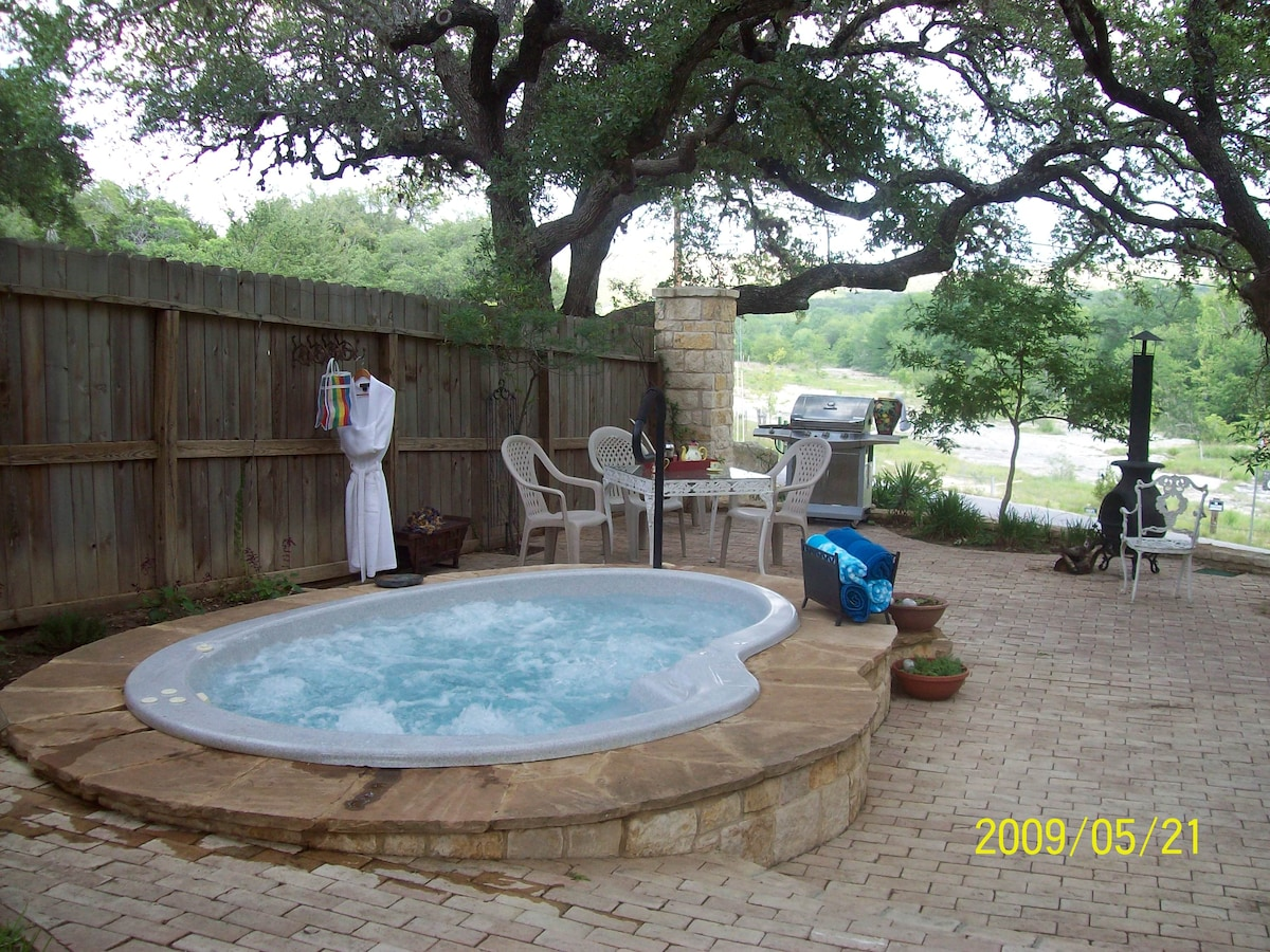 Relax in the hot tub after a swim in the beautiful Blanco River.  This is up next to the house, across the street from the river.