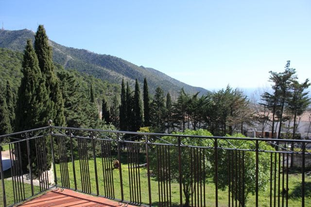 View from room 1 of garden, mountain and sea.