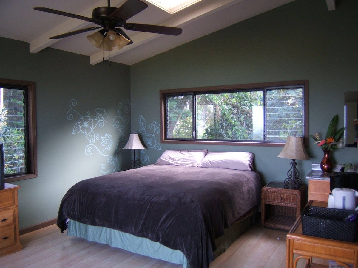 Upstairs master bedroom.  King size bed garden and ocean views.