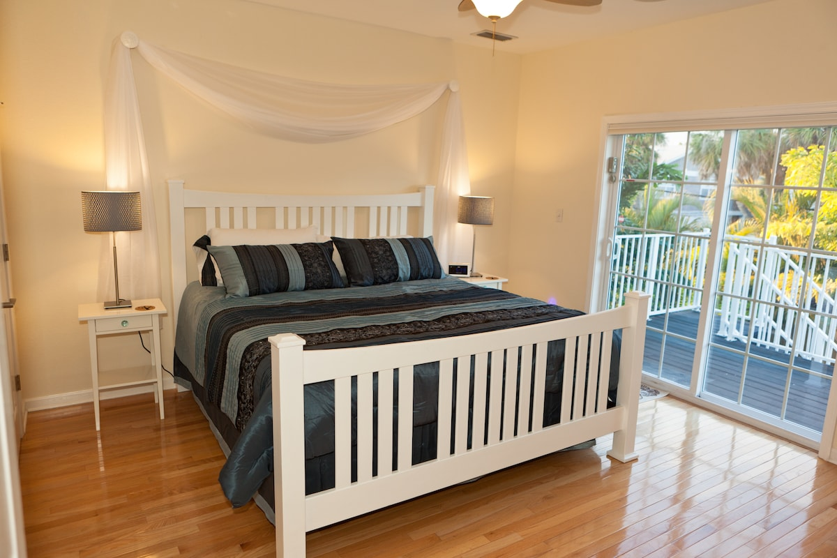 Master bedroom with a king size bed and inviting night light design