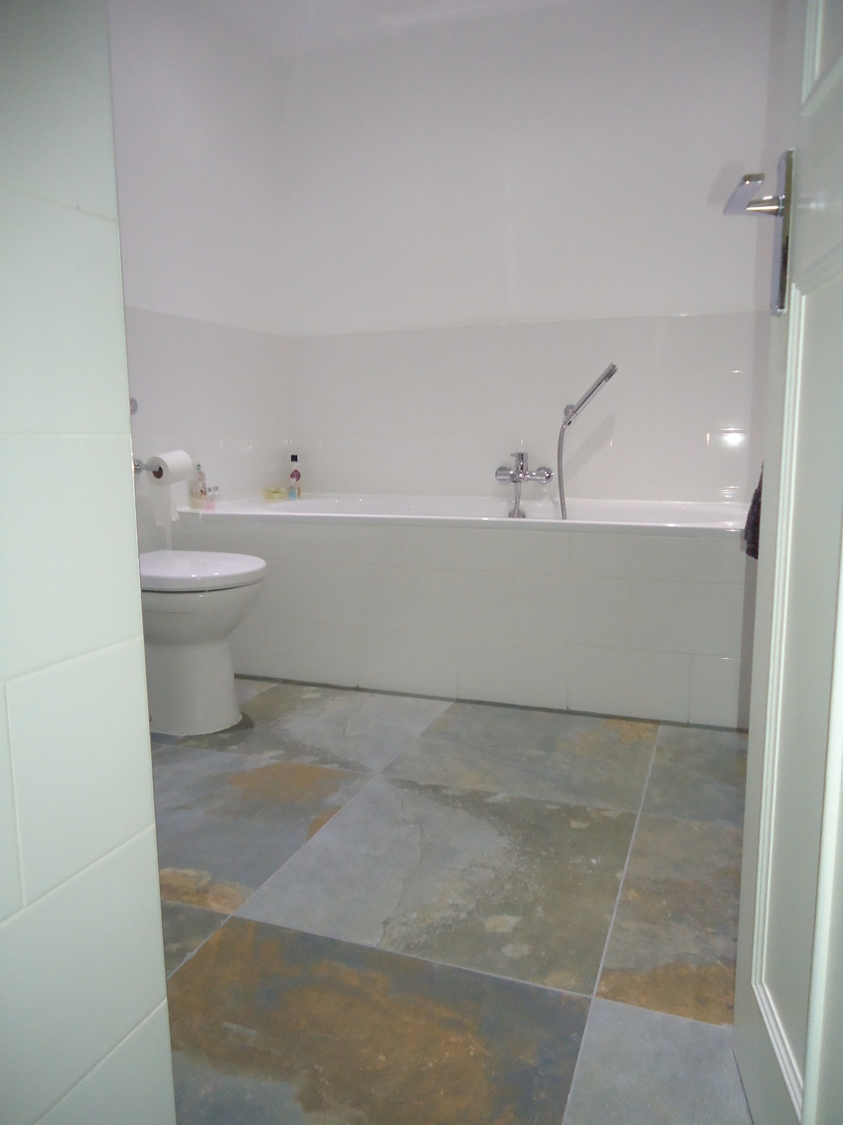 Luxury ensuite with huge bath, underfloor central heating, heated towel rail and even a couple of comfy dressing gowns!