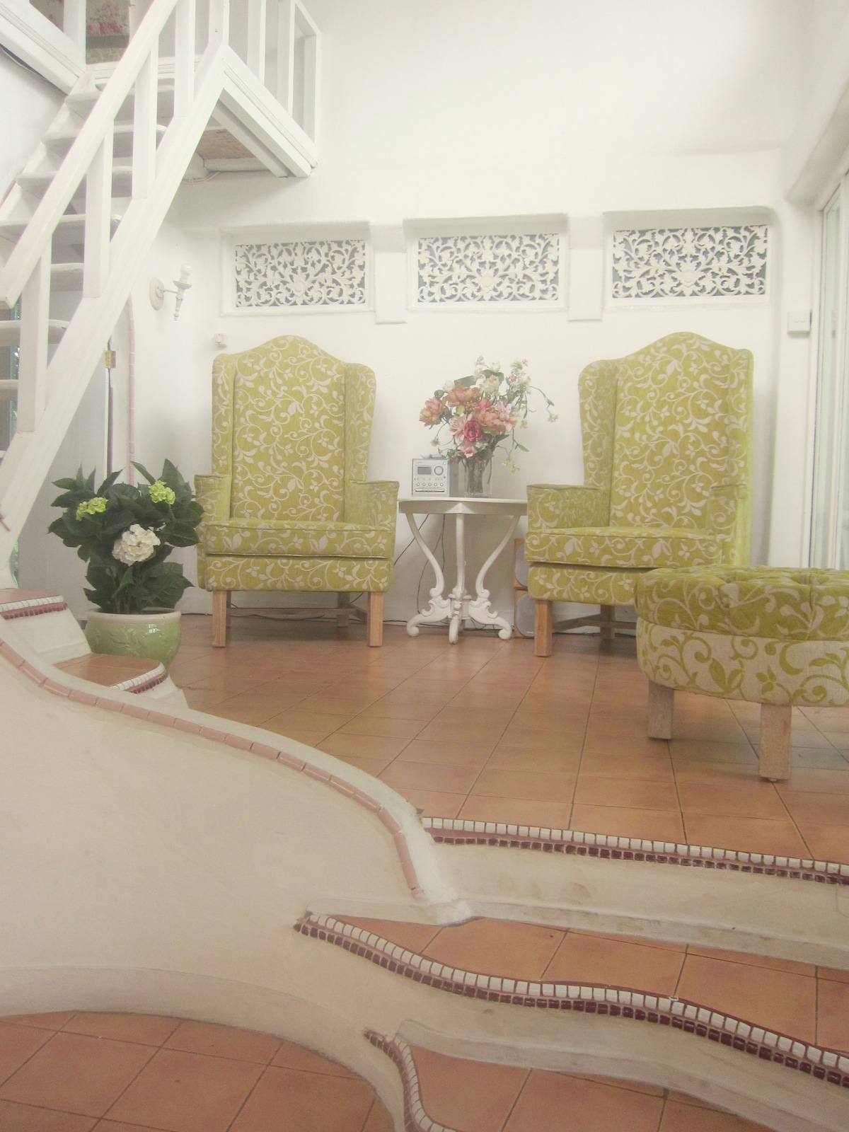 High back throne chairs in the light and airy foyer