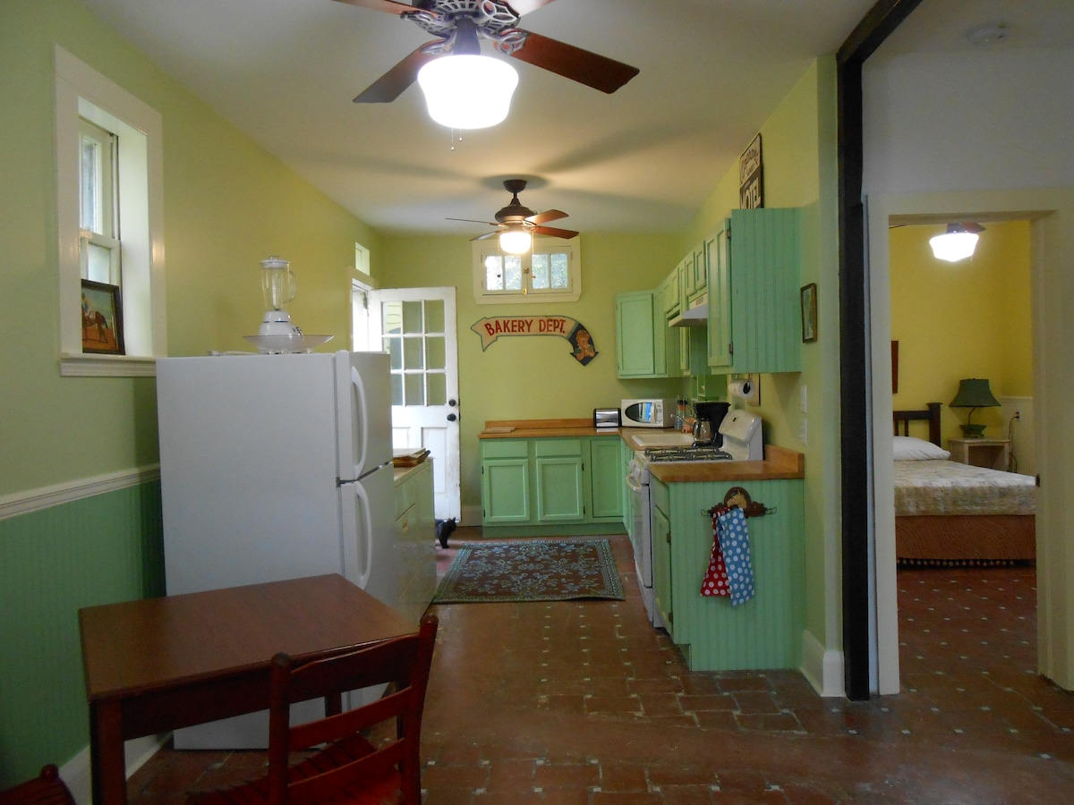 Dining room and kitchen, Door leading to outdoor courtyard.
