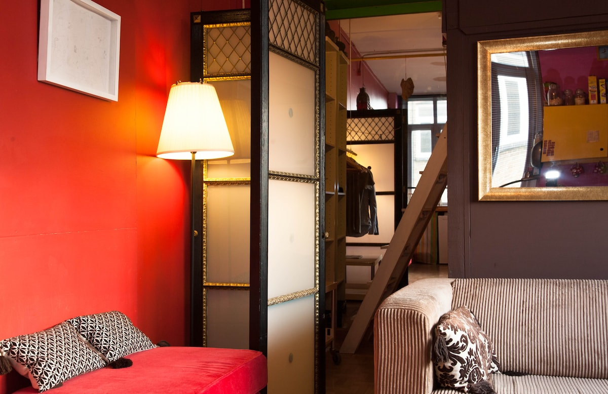 The Lounge, behind the sofa is a double bed and a mezzanine bed above it.