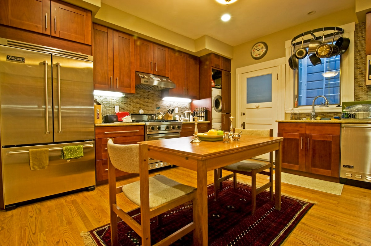 Chef's Kitchen with professional-grade Viking appliances and built-in clothes washer/dryer