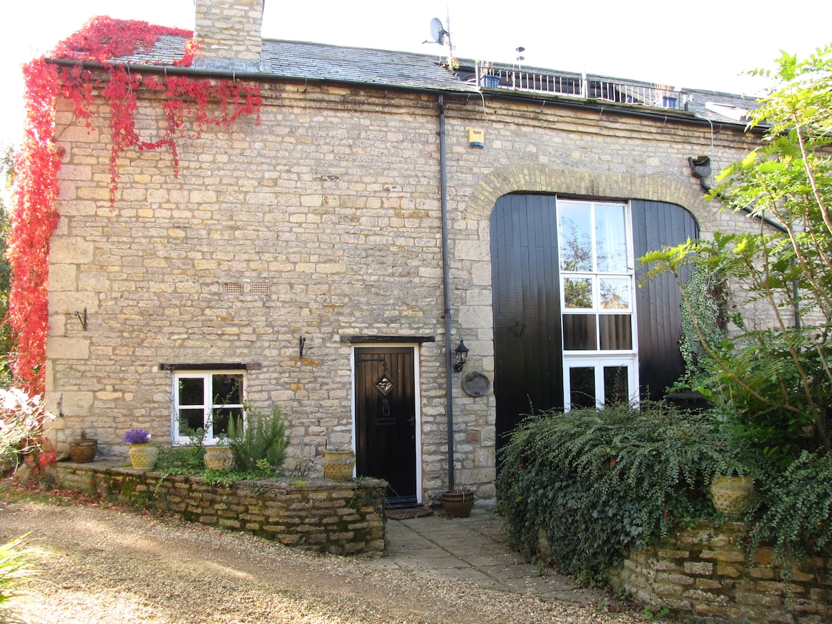 Rear view of barn with front door and roof terrace shown top right
