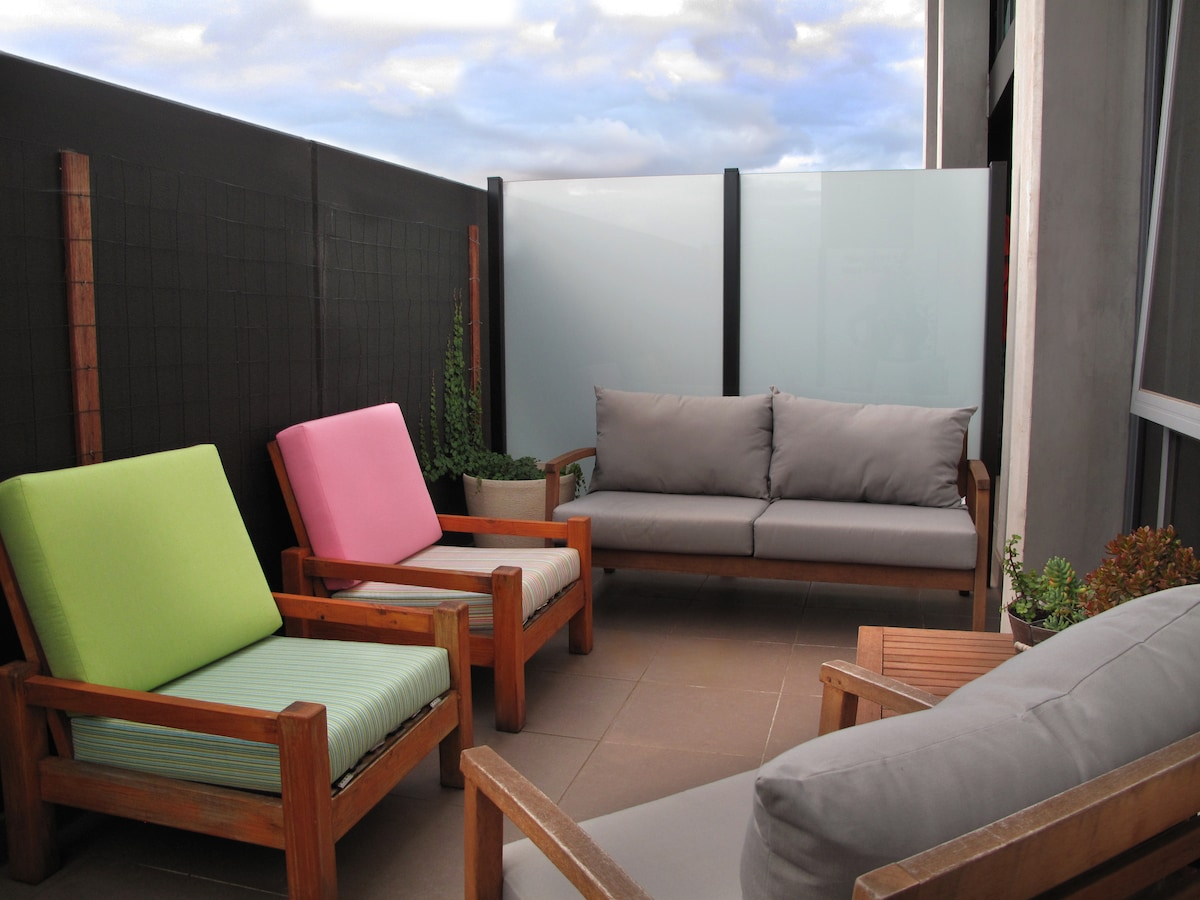 The private outdoor balcony area! (Cushions are under bed)
