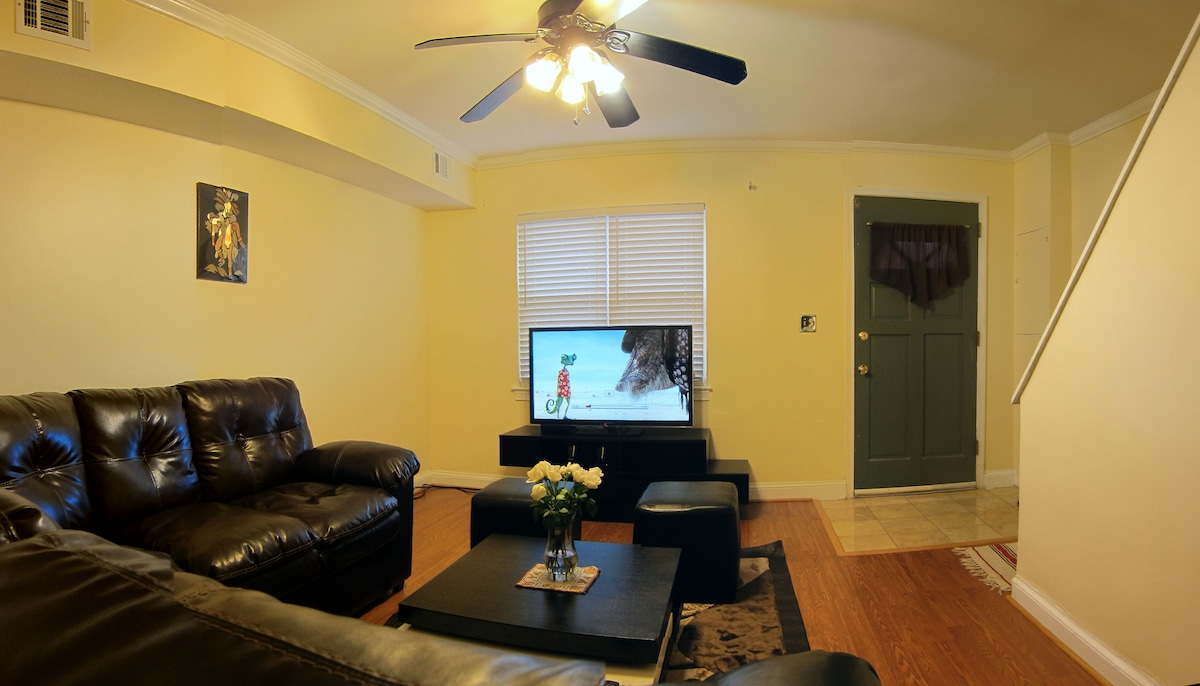 The living room featuring brand new 47'' Panasonic TV with cable and Netflix - more than 100,000 movies included