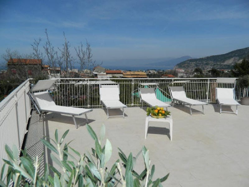 Exclusive Terrace Solarium equipped with sun beds, sun chairs, shower, tables, chairs, barbecue