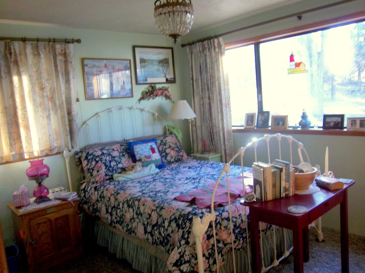 The quaint Cape Cod Room has a full bed with a private entrance and a half bath