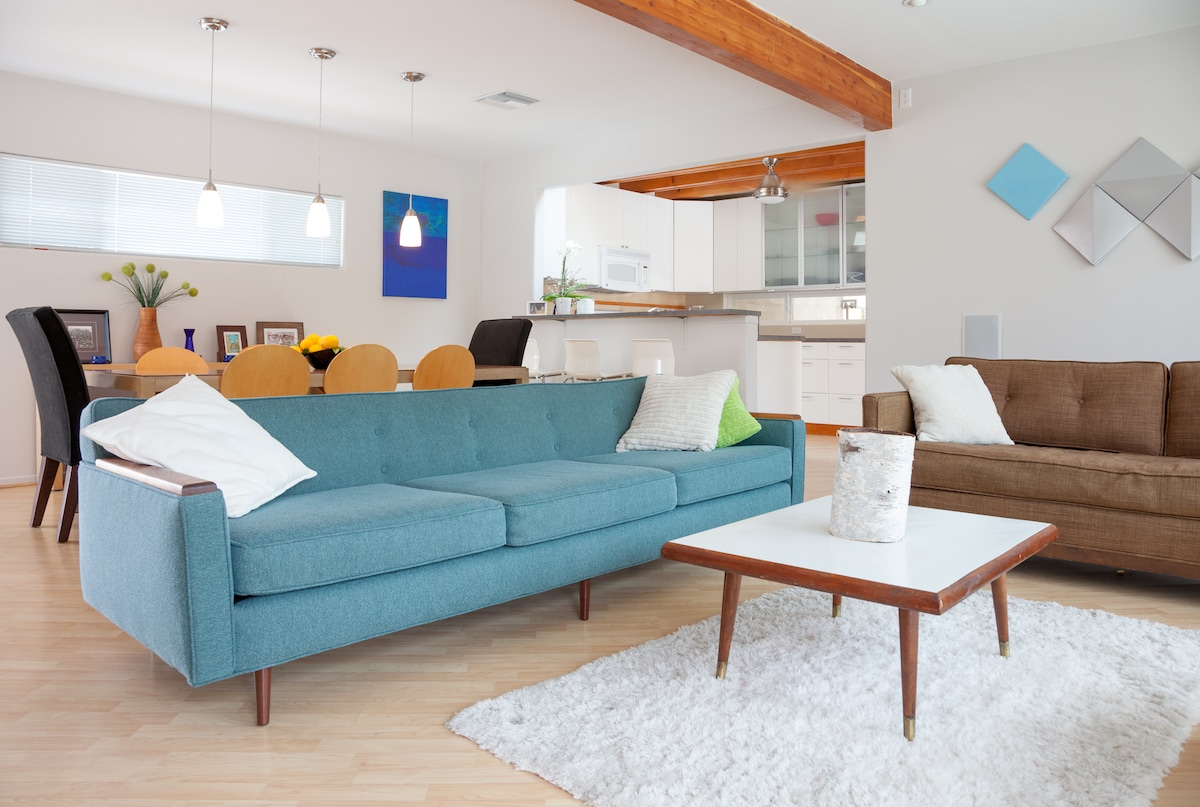 Put your feet up and enjoy the air conditioning in this peaceful, spacious, hip, mid-century modern living room.