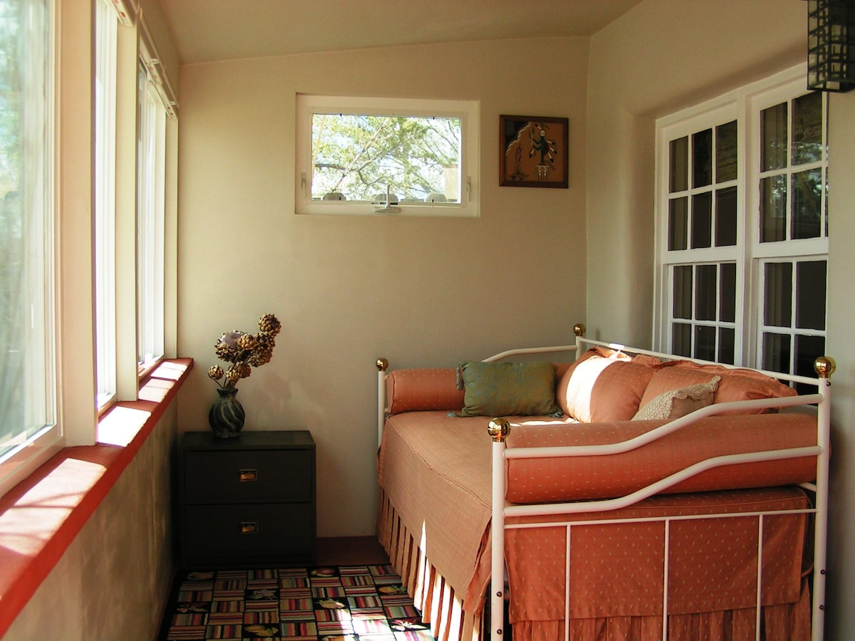 Sunny front porch with blackout blinds and daybed - for reading/sleeping/or surfing the web