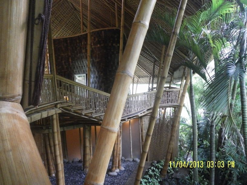 View of right area of Palm Villa as seen from the entrance stairs. The guest bedroom is located behind the dark brown woven bamboo walling in the centre