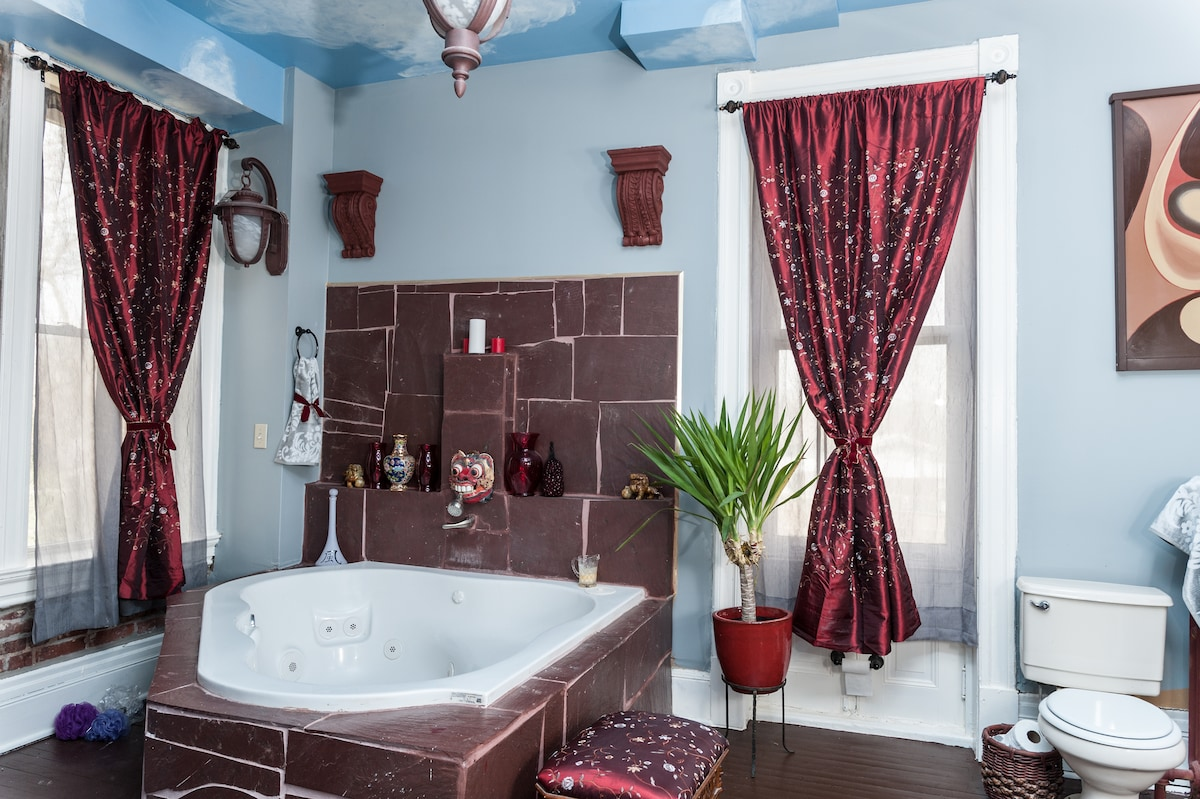 Adjoining, large bathroom with soaker tub and separate shower