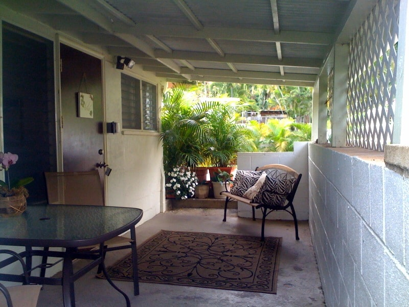 Your private entrance, with large covered lanai with full size table and chairs, stairs at back connect to hillside garden area and a two lounges for relaxing.
